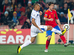Sergio Mendoza of Honduras vs Joan Capdevila of Spain during the 2010 FIFA World Cup South Africa Group H Second Round match between Spain and Honduras on June 21, 2010 at Ellis Park Stadium, Johannesburg, South Africa.  Spain defeated Honduras 2-0. (Photo by Vid Ponikvar / Sportida)