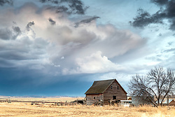 An old barn stands defiant against the elements of eastern Idaho's snow, sun, rain and hail.  Sadly day by day these beautiful relics of the past fall victim to the violent weather of beautiful thunderheads every day.  this Ririe Idaho makes it through another.