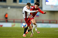 Scunthorpe United John McAtee (45) Morecambe FC Cole Stockton (9) battles for possession during the EFL Sky Bet League 2 match between Morecambe and Scunthorpe United at the Globe Arena, Morecambe, England on 13 April 2021.