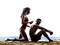 one caucasian couple man and woman on the beach applying sun protection  silhouette isolated on white background