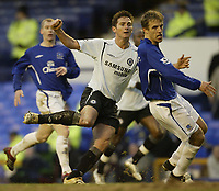 Photo: Aidan Ellis.<br /> Everton v Chelsea. The FA Cup. 28/01/2006.<br /> Chelsea's Frank Lampard watches his equaliser going in as Everton's Phil Neville looks on
