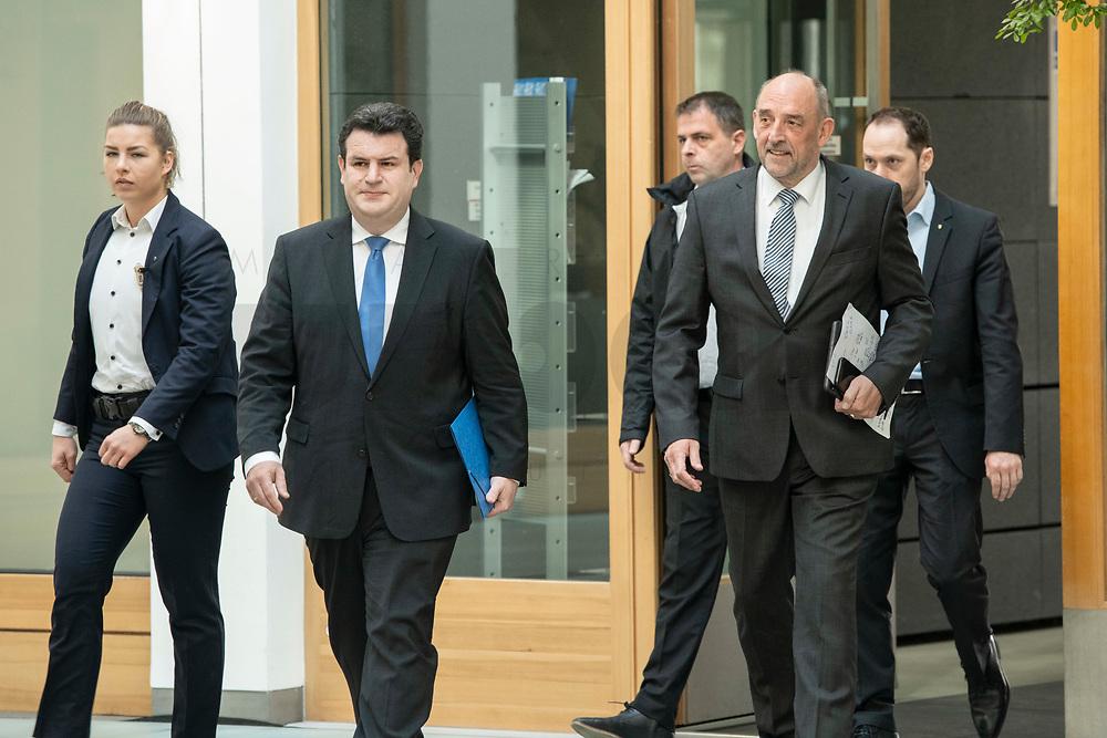 """31 MAR 2020, BERLIN/GERMANY:<br /> Hubertus Heil (L), SPD, Bundesarbeitsminister, und Detlef Scheele (R), Vorsitzender des Vorstandes der Bundesagentur für Arbeit, mit Personenschuetzern auf dem Weg zu einer Pressekonferenz zum Thema """"Zur Lage am deutschen Arbeitsmarkt"""" waehrend der Corona-Krise, Bundespressekonferenz<br /> IMAGE: 20200331-01-001<br /> KEYWORDS: BPK"""