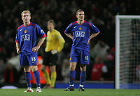 Photo: Paul Thomas.<br /> Arsenal v Manchester United. The Barclays Premiership. 21/01/2007.<br /> <br /> Paul Scholes (L) and Nemanja Vidic of Man Utd show their dejected after Arsenal score their second to win.