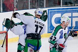 Ziga Pavlin (HDD Tilia Olimpija, #17) hugs goalie Matija Pintaric (HDD Tilia Olimpija, #69) during ice-hockey match between HDD Tilia Olimpija and EHC Liwest Black Wings Linz in 19th Round of EBEL league, on November 7, 2010 at Hala Tivoli, Ljubljana, Slovenia. (Photo By Matic Klansek Velej / Sportida.com)