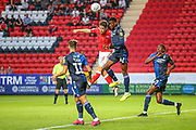 Charlton Athletic defender Tom Lockyer (5) wins a header over Nottingham Forest midfielder Alfa Semedo (17) during the EFL Sky Bet Championship match between Charlton Athletic and Nottingham Forest at The Valley, London, England on 21 August 2019.