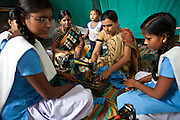 A sewing class at the Kasturba Gandhi Balika Vidayala School in Gorakhpur, India. These girls wouldn't normally be able to go to school and are funded by Manav Seva Sansthan, MSS organisation. The non-profit organization pay for their rent, food and clothes as part of the anti trafficking project.