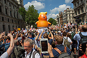 Mini Trump Baby joins the Women's March Against Trump as it arrives in Parliament Square, London, United Kingdom. 13th July 2018.