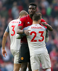Manchester United's Paul Pogba (left) and Liverpool's Xherdan Shaqiri embrace after the final whistle