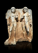 Roman Sebasteion relief  sculpture of  Two princes, Aphrodisias Museum, Aphrodisias, Turkey.  Against a black background.<br /> <br /> Two princes stand like statues, naked, wearing cloaks. The left figure holds the orb of the world in one hand, a symbol of  world rule that indicates he is the imperial heir, and in the other a ship's stern ornament (aphlaston), a symbol of naval victory. They and probably Gius and Lucius, the grandsons of Augustus, or Nero and Britanicus, Claudius' heir. .<br /> <br /> If you prefer to buy from our ALAMY STOCK LIBRARY page at https://www.alamy.com/portfolio/paul-williams-funkystock/greco-roman-sculptures.html . Type -    Aphrodisias     - into LOWER SEARCH WITHIN GALLERY box - Refine search by adding a subject, place, background colour, museum etc.<br /> <br /> Visit our ROMAN WORLD PHOTO COLLECTIONS for more photos to download or buy as wall art prints https://funkystock.photoshelter.com/gallery-collection/The-Romans-Art-Artefacts-Antiquities-Historic-Sites-Pictures-Images/C0000r2uLJJo9_s0