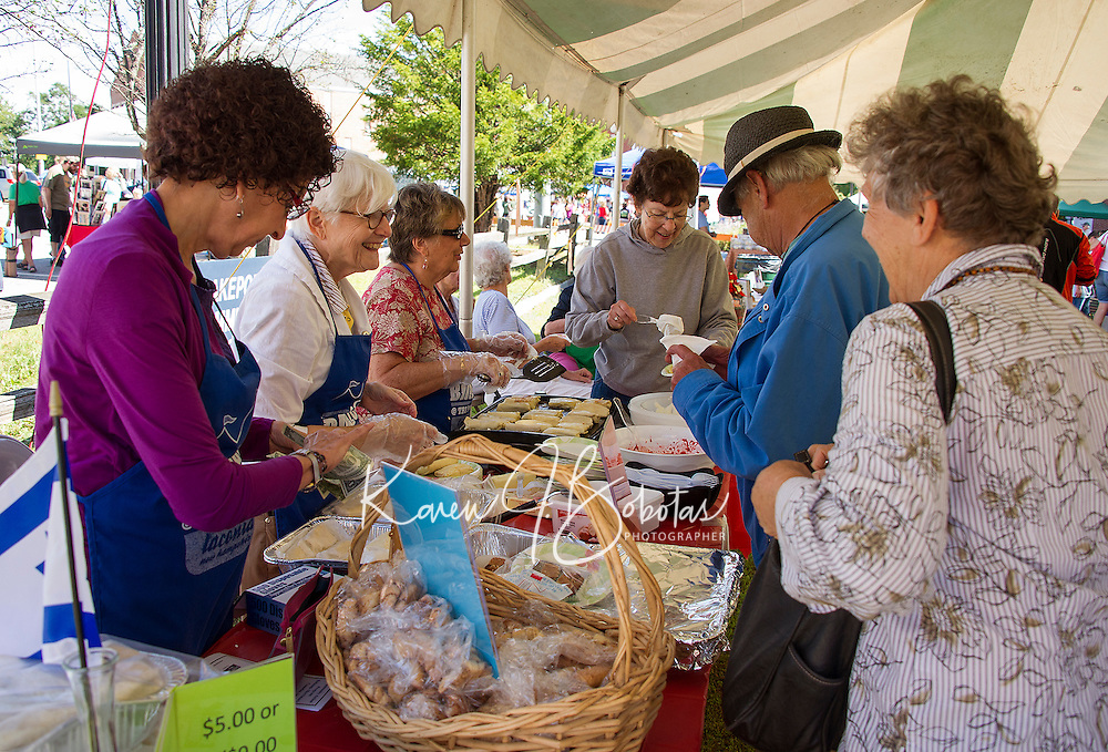 Fredda Osman, Joyce Selig, Irene Gordon and Sharon Fleischman serve Strawberry Blintzes during Saturday's Multi Cultural Festival in downtown Laconia.  (Karen Bobotas/for the Laconia Daily Sun)