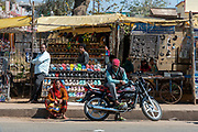 Sellings shoes and other items on the street of Seoni, madhya Pradesh, India.