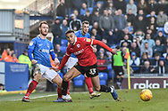 Portsmouth Midfielder, Tom Naylor (7) and Barnsley Forward, Jacob Brown (33) during the EFL Sky Bet League 1 match between Portsmouth and Barnsley at Fratton Park, Portsmouth, England on 23 February 2019.
