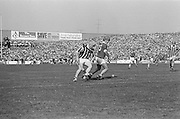 Kilkenny tries to get around Cork to gain possession during the All Ireland Senior Hurling Final, Cork v Kilkenny in Croke Park on the 3rd September 1972. Kilkenny 3-24, Cork 5-11.