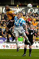 Photo: Ed Godden.<br />Wolverhampton Wanderers v Brighton & Hove Albion. Coca Cola Championship. 22/04/2006. Carl Cort (L) and Paul McShane (Brighton), clash in the air.
