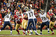 San Francisco 49ers defensive end Quinton Dial (92) gets his fingers on a pass by Los Angeles Rams quarterback Case Keenum (17) at Levi's Stadium in Santa Clara, Calif., on September 12, 2016. (Stan Olszewski/Special to S.F. Examiner)