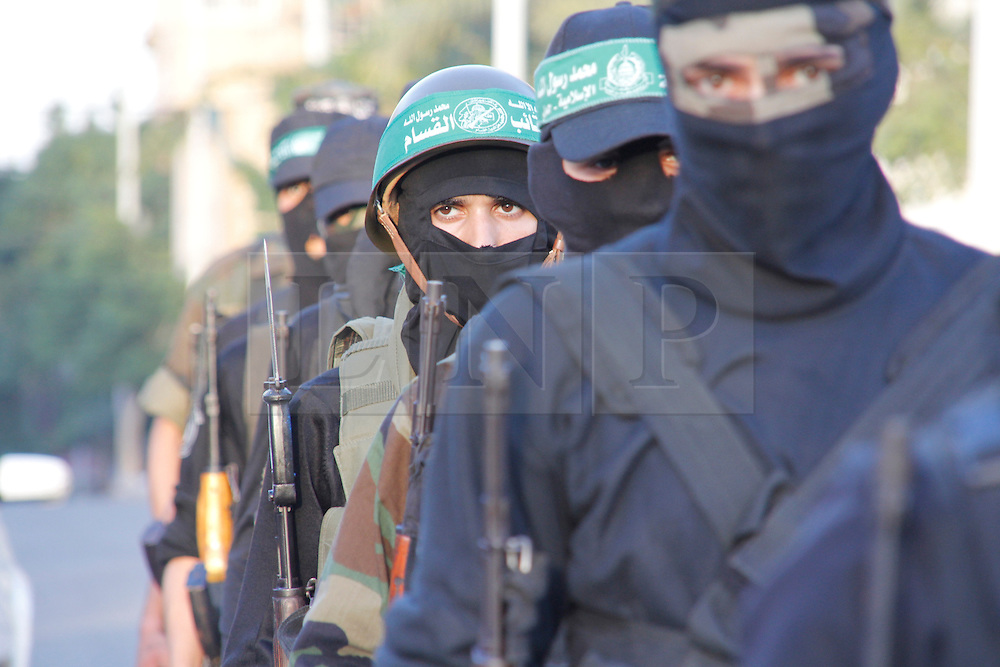© London News Pictures. 02/12/2012. Gaza. Members of the Ezzedeen Al-Qassam Brigades, the military wing of Hamas, take part in a military parade through Gaza city on December 02, 2012. The parade was part of a series of ceremonies to commemorate the 25th anniversary of Hamas establishment.  Photo credit: Ahmed Deeb/LNP