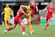 Aberdeen's Niall McGinn (10) and Jackson Longridge(23) of Livingston battles for possession, tussles, tackles, challenges, during the Scottish Premiership match between Livingston and Aberdeen at Tony Macaroni Arena, Livingstone, Scotland on 1 May 2021.
