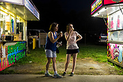 WASHINGTON, USA - August 19: A mother and daughter enjoy ice cream between two food vendors at the Montgomery County Agricultural Fair in Gaithersburg, Md., USA on August 19, 2017.