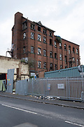 Derelict mill factory red brick building in an Industrial Estate in Nechells, the inner city area of Birmingham which is virtually deserted under Coronavirus lockdown on 29th April 2020 in Birmingham, England, United Kingdom. Coronavirus or Covid-19 is a new respiratory illness that has not previously been seen in humans. While much or Europe has been placed into lockdown, the UK government has put in place more stringent rules as part of their long term strategy, and in particular social distancing.