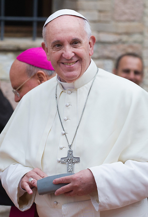 ASSISI, ITALY - OCTOBER 04:  Pope Francis leaves S Damiano Sanctuary on October 4, 2013 in Assisi, Italy.  Pope Francis is due to venerate the tomb of San Francesco of Assisi at the crypt of the Upper Basilica of Saint Francis tomorrow during his one-day visit to the city.  (Photo by Marco Secchi/Getty Images)