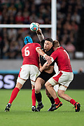 Sonny Bill Williams of New Zealand is tackled by Justin Tipuric of Wales (left) and James Davies of Wales during the Rugby World Cup bronze final match between New Zealand and Wales Friday, Nov, 1, 2019, in Tokyo. New Zealand defeated Wales 40-17.  (Flor Tan Jun/Espa-Images-Image of Sport)