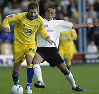 Photo: Marc Atkins.<br /> <br /> <br /> <br /> Luton Town v Leeds United. Coca Cola Championship. 21/10/2006. Richard Cresswell (L) and  Dean Morgan of Luton (R) battle for the ball.