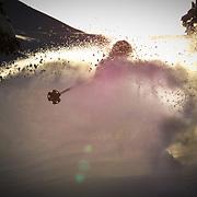 Tyler Hatcher skis backlit powder in the backcountry near Mount Baker Ski Area.