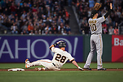 San Francisco Giants catcher Buster Posey (28) slides into second base against the Pittsburgh Pirates at AT&T Park in San Francisco, California, on July 25, 2017. (Stan Olszewski/Special to S.F. Examiner)