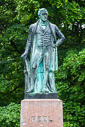 © Licensed to London News Pictures. 10/06/2020. Leeds UK.  A statue in Leeds has been highlighted as a symbol of slavery and colonialism by anti-racism campaigners.<br /> The Grade II-listed monument of former British prime minister Sir Robert Peel has stood at the northern edge of Woodhouse Moor, Hyde Park, since 1937. However, campaigners have now launched a petition which states that it should be removed. It comes after a statue of slave trader Edward Colston was toppled by large crowds of Black Lives Matter protestors in Bristol. Several other statues in other cities across the UK are now being highlighted as monuments that glorify British colonialism. Photo credit: Andrew McCaren/LNP