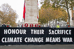 "© Licensed to London News Pictures. 11/11/2020. London, UK. Extinction Rebellion activists have hung a banner that reads ""Honour Their Sacrifice , Climate Change Means War"" at the Cenotaph . Later today there will be an Armistice Service at Westminster Abbey. Photo credit: George Cracknell Wright/LNP"