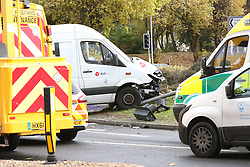 Portsmouth,Hampshire Tuesday 15th November 2016  Traffic s at standstill following a collision in Portsmouth Hamphire . A DPD delivery van collided with three sets of traffic lights on the busy Mile End road roundabout just after 10.30am this morning. Police and emergency services and council contractors attended and a massive clean up and recovery operation is in progress to remove the van from the centre of the roundabout.<br /> <br /> The driver of the van is not thought to be seriously injured. He  was taken away by ambulance to the QA hospital in Cosham. Council contractors Colas have started to remove damaged lights and recovery specialists from Boarhunt have winced the van from the middle of the roundabout. Two lanes of the roundabout remain closed and will do overnight. Barriers have been moved into place.<br /> It is thought that the repair bill will run into thousands and will take many weeks to be completed.<br /> <br /> Watch the aftermath of the DPD delivery van that has hit traffic signals and the clean up operation in Portsmouth.©UKNIP<br /> Video :<br /> https://youtu.be/AW8w4E1eulA