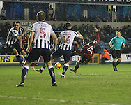 Calum Butcher of Millwall and James O'Brien of Shrewsbury Town during the Sky Bet League 1 match at The Den, London<br /> Picture by Richard Brooks/Focus Images Ltd 07947656233<br /> 10/12/2016