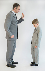 Father blusters his son against white background