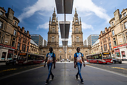Glasgow, Scotland, UK. 12 June 2020. View of West George Street and Tron Church reflected in shop window. Although shops can reopen in England next week , in Scotland the lockdown is not being relaxed so quickly with several more weeks of restrictions to go. Shops and businesses remain closed and streets are very quiet.  Iain Masterton/Alamy Live News