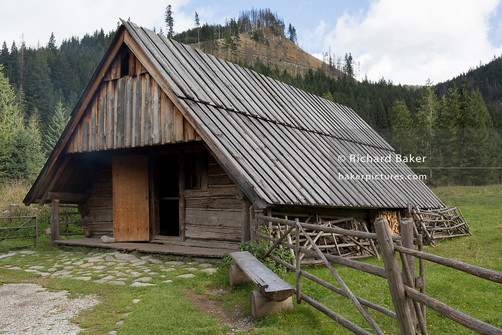 A traditional agricultural hut in Dolina Chocholowska, a hiking route in the Tatra National Park, on 17th September 2019, near Zakopane, Malopolska, Poland. Smoke houses such as these sell Oszczypek, a smoked cheese made of salted sheep milk exclusively in the Tatra Mountains region of Poland.