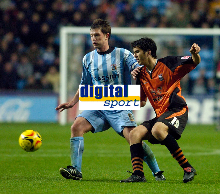 Photo: Leigh Quinnell.<br /> Coventry City v Ipswich Town. Coca Cola Championship.<br /> 19/11/2005. Coventrys Stephen Hughes battles with Ipswichs' Jimmy Juan.