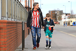 Southampton supporting father and Tottenham Hotspur supporting son arrive at the the ground before the game