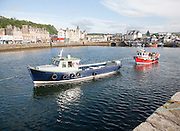 Fishing boats moored in the harbour at Oban, Argyll and Bute, Scotland, UK
