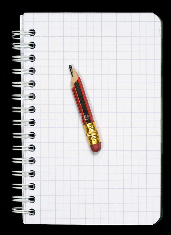 folded notebook with a little old pencil stump with eraser
