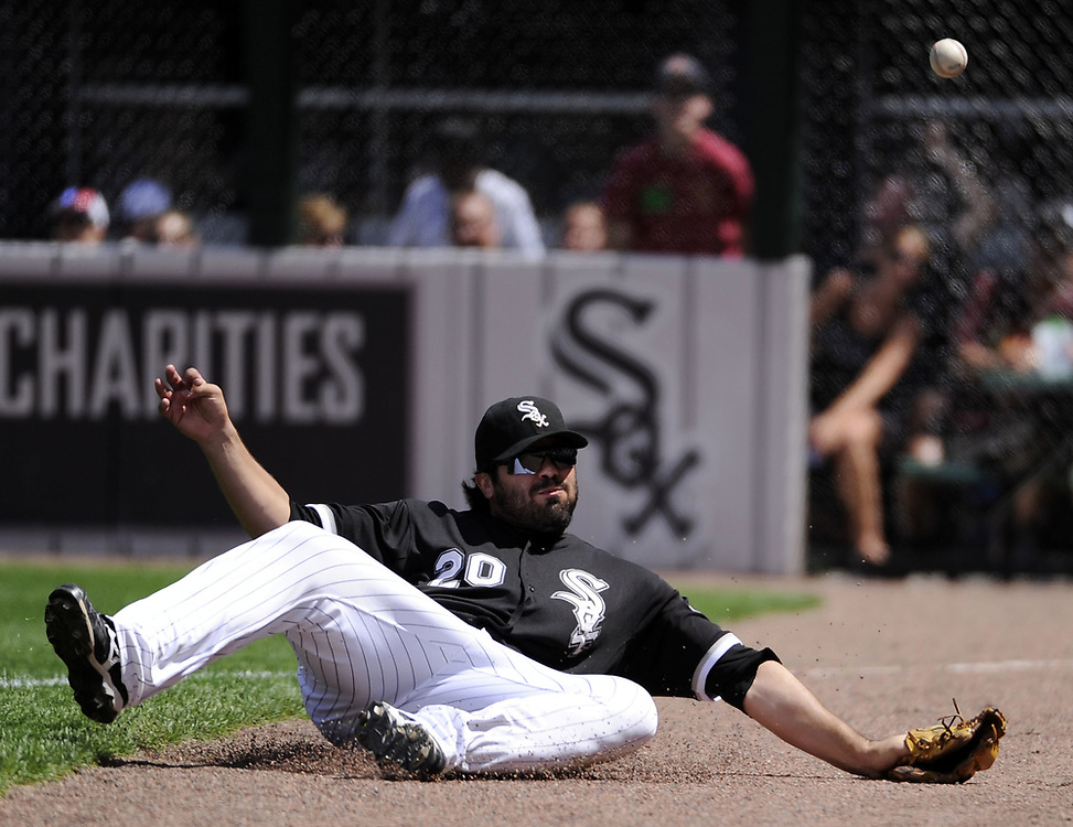 CHICAGO - JUNE 27:  Carlos Quentin #20 of the Chicago White Sox dives but cannot catch the ball during the game against the Chicago Cubs on June 27, 2010 at U.S. Cellular Field in Chicago, Illinois.  The Cubs defeated the White Sox 8-6.  (Photo by Ron Vesely)