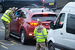 © Licensed to London News Pictures 26/12/2020.        Dover, UK.  Army soldiers helping to test people in Dover. Over 1000 lorries are left queuing on the M20 heading for Dover as Manston Airport is cleared. Emergency services and military personnel continue to tests travellers at Dover in Kent for Coronavirus before they cross the English Channel. Photo credit:Grant Falvey/LNP