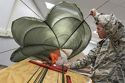 Apr 26, 2017 - Georgia, U.S. - Parachute Inspection. Air Force Staff Sgt. Scott Watson inspects a parachute at Robins Air Force Base, Ga., April 26, 2017. Watson is an aircrew flight equipment technician assigned to the 339th Flight Test Squadron. Air Force photo by Jamal D. Sutter. (Credit Image: ? Jamal D. Sutter/DoD via ZUMA Wire/ZUMAPRESS.com)