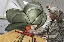 Apr 26, 2017 - Georgia, U.S. - Parachute Inspection. Air Force Staff Sgt. Scott Watson inspects a parachute at Robins Air Force Base, Ga., April 26, 2017. Watson is an aircrew flight equipment technician assigned to the 339th Flight Test Squadron. Air Force photo by Jamal D. Sutter. (Credit Image: ? Jamal D. Sutter/DoD via ZUMA Wire/ZUMAPRESS.com)