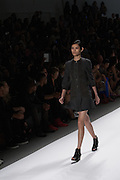 A back tone-on-tone dress with three-quarter sleeves by Richard Chai at the Spring 2013 Mercedes Benz Fashion Week show in New York.