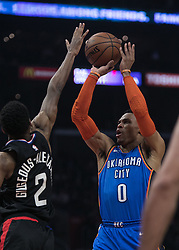 March 8, 2019 - Los Angeles, California, United States of America - Shai Gilgeous-Alexander #2 of the Los Angeles Clippers tries to block a shot by Russell Westbrook #0 of the Oklahoma Thunder during their NBA game on Friday March 8, 2019 at the Staples Center in Los Angeles, California. Clippers defeat Thunder, 118-110.  JAVIER ROJAS/PI (Credit Image: © Prensa Internacional via ZUMA Wire)