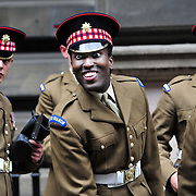 1st Battalion Scots Guards (1SG) parade in Glasgow on Saturday, 1 June 2013 to celebrate their return from a six-month tour in Afghanistan.<br />  <br /> The battalion spent six months in Helmand Province when they were deployed to the Upper Gereshk Valley. Clement Mutangana only has eyes for his daug  hter Nyla.Picture Robert Perry The Scotsman 1st June 2013