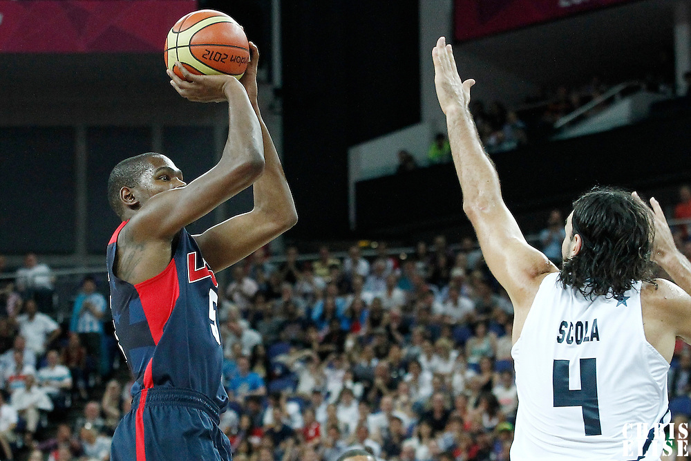 10 August 2012: USA Kevin Durant takes a jumpshot over Argentina Luis Scola during 109-80 Team USA victory over Team Argentina, during the men's basketball semi-finals, at the North Greenwich Arena, in London, Great Britain.