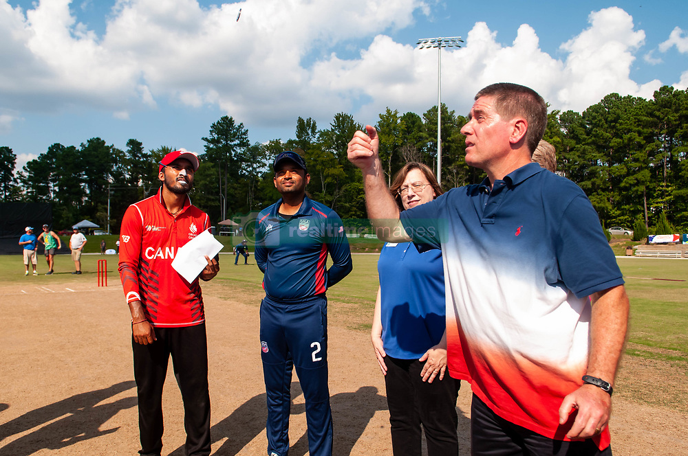 September 22, 2018 - Morrisville, North Carolina, US - Sept. 22, 2018 - Morrisville N.C., USA - T.J. CAWLEY, mayor of Morrisville, N.C, flips the coin as MOHAMMED KHALEEL, Team USA captain, center, and NITISH KUMAR, Team Canada captain, look on during the ICC World T20 America's ''A'' Qualifier cricket match between USA and Canada. Both teams played to a 140/8 tie with Canada winning the Super Over for the overall win. In addition to USA and Canada, the ICC World T20 America's ''A'' Qualifier also features Belize and Panama in the six-day tournament that ends Sept. 26. (Credit Image: © Timothy L. Hale/ZUMA Wire)