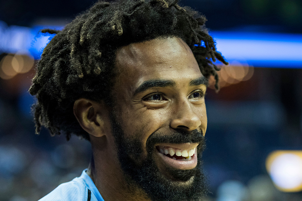 MEMPHIS, TN - OCTOBER 26:  Mike Conley #11 of the Memphis Grizzlies warming up before a game against the Dallas Mavericks at the FedEx Forum on October 26, 2017 in Memphis, Tennessee.  NOTE TO USER: User expressly acknowledges and agrees that, by downloading and or using this photograph, User is consenting to the terms and conditions of the Getty Images License Agreement.  The Grizzlies defeated the Mavericks 96-91.  (Photo by Wesley Hitt/Getty Images) *** Local Caption *** Mike Conley