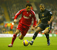 Photo: Aidan Ellis.<br /> Liverpool v Watford. The Barclays Premiership. 23/12/2006.<br /> Liverpool's Jermain Pennant (L) beats Watford's Hameur Bouazza